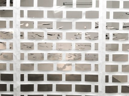 """installation at the Minnesota Street Project featuring paper hanging boats seen through a """"brick"""" screen"""